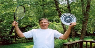 Dad_holding_racquet_and_plate_2