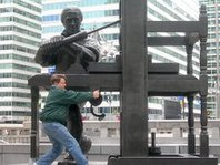 Chris Lancette gives Ben Franklin a hand with printing press, by Robert Speers